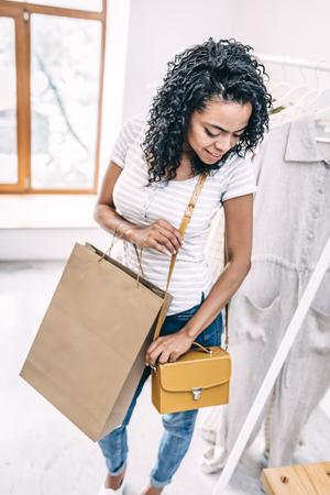 Black woman trying new handbag