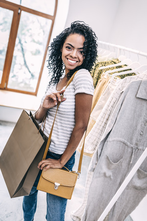 Pretty woman choosing stylish handbag Stock Photo