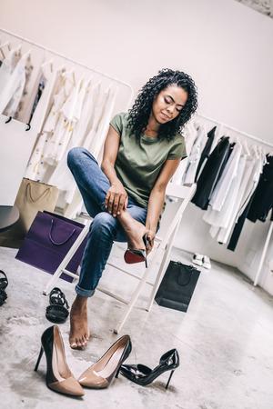 Casual woman choosing trendy heels in shop Stock Photo
