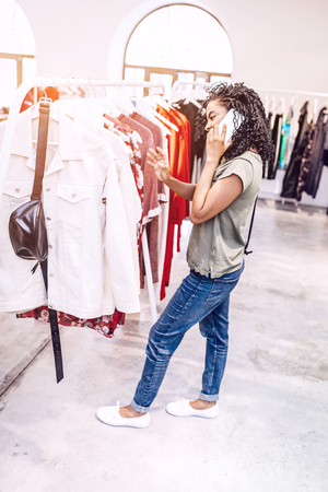 Black woman shopping and chatting on phone