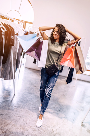 Casual black woman with shopping bags Stock Photo