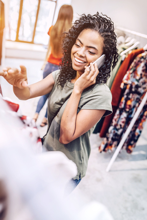 Casual woman in shop having phone Stock Photo