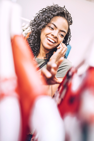 Laughing woman speaking on phone in shop Stock Photo