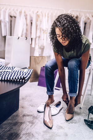 Black woman trying on new shoes Stock Photo