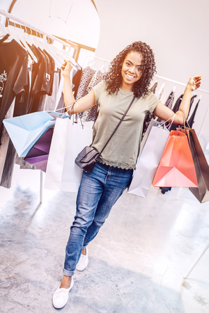 Bright woman carrying shopping bags Stock Photo