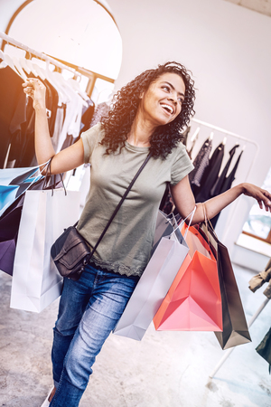 Laughing black woman with shopping bags