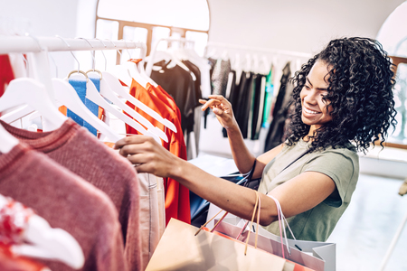 Casual woman choosing clothes