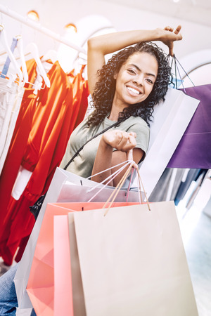 Coquette black woman with bags in shop Stock Photo