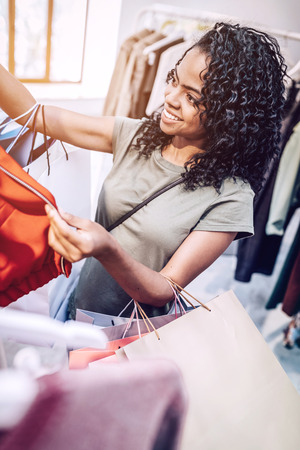 Young happy woman shopping in clothes store Stock Photo