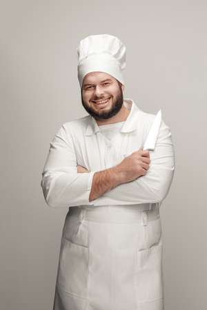 Confident cook with sharp knife