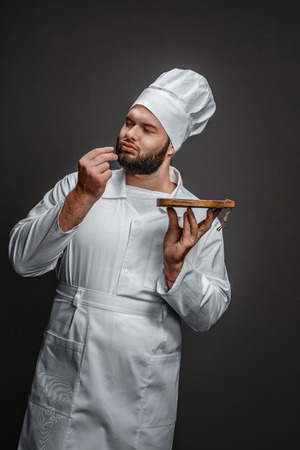 Chef with board kissing fingers Stock fotó