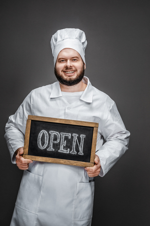 Smiling chef with open writing