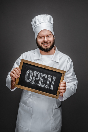 Friendly cook showing open writing