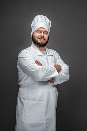 Confident chef looking at camera