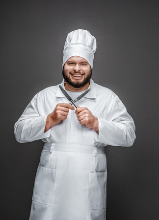 Excited chef with small knives