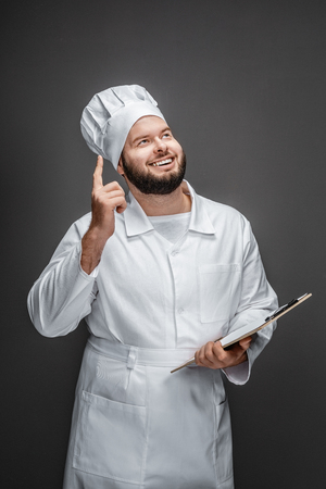 Chef with clipboard having idea