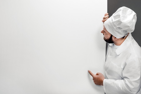 Chef pointing at empty whiteboard