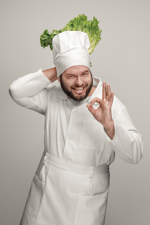 Cook with lettuce leaf gesturing OK