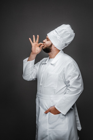 Professional cook kissing fingers Stock fotó