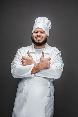 Confident chef showing thumb up gesture