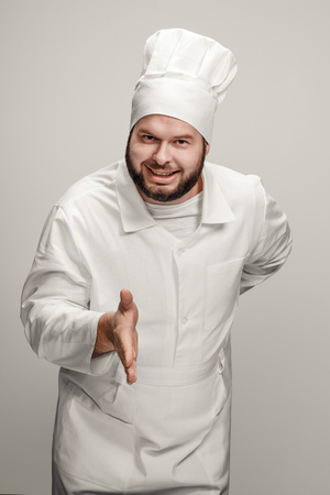 Smiling chef offering hand for handshake Stock fotó