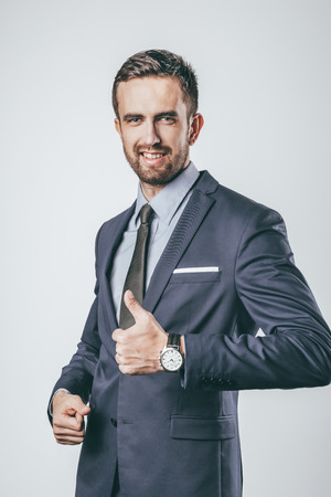Smiling businessman gesturing thumb up Stock fotó