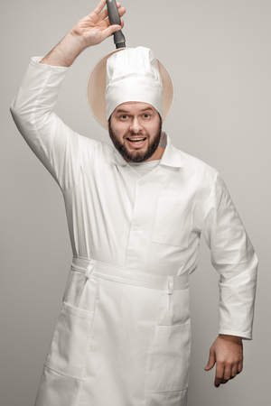 Bearded chef having fun with frying pan