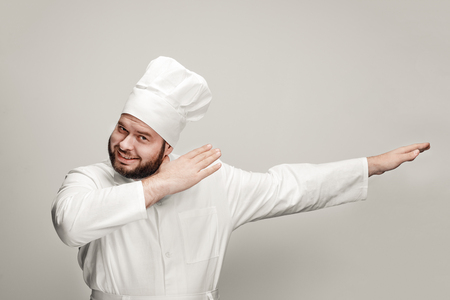 Cheerful chef dabbing and looking at camera