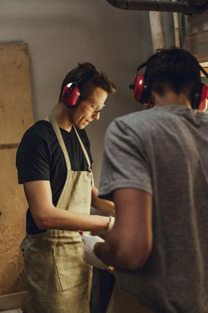 Focused men working in workshop