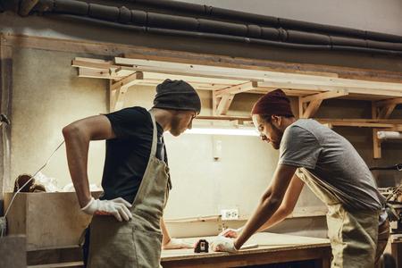 Professional carpenters making draft
