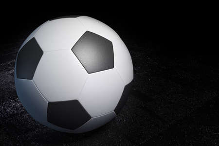 wet: Soccer ball on the wet stone floor Stock Photo