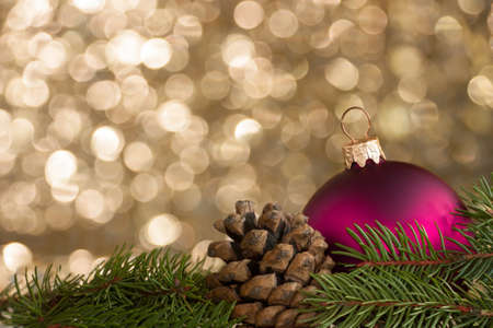 Christmas decoration on spruce, pine cones and ball photo