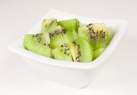 white bowl with pieces of sliced kiwi Stock Photo