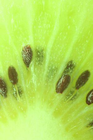 Macro close-up view of a green kiwi