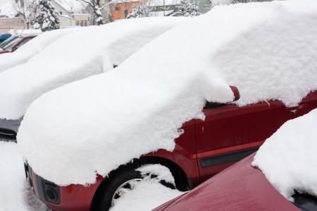 car covered with snow in winter photo