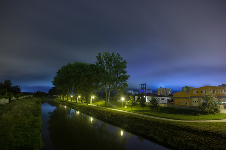 Night urban landscape with river lit