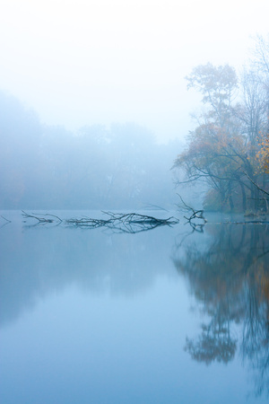 Morning fog at autumn lake photo