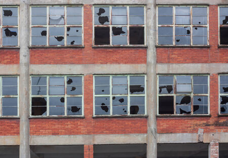 old building with broken windows Stock Photo