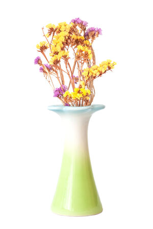 green vase with dried flowers Stock Photo