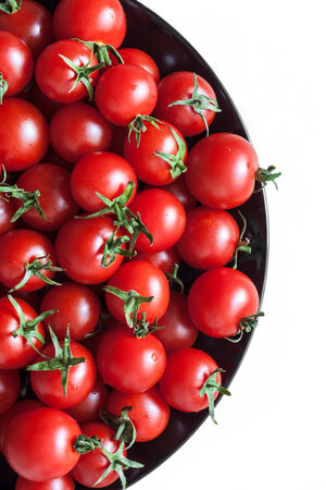 plate full of ripe red cherry tomatoes