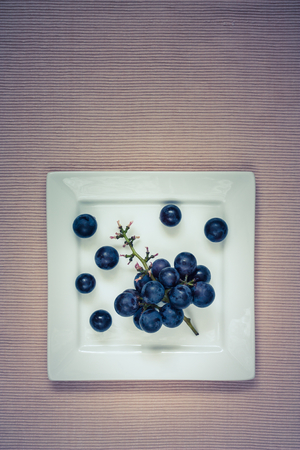 grapevine on a white plate