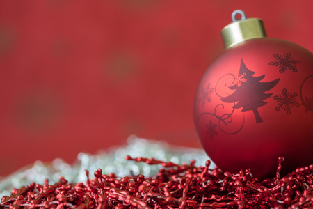 Christmas ball with a red and silver background Stock Photo