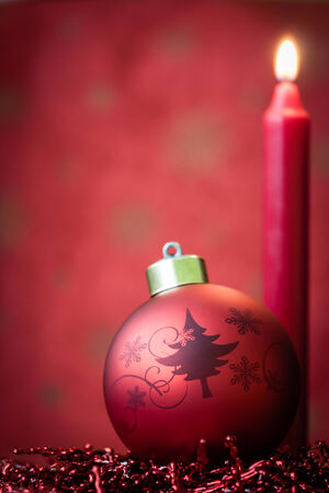 Red Christmas ornament with candle