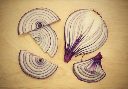 halved onions on a wooden background Stock Photo