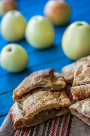 sliced ​​apple strudel on a blue table photo