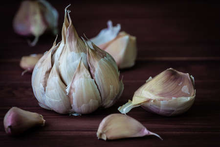 garlic on a wooden background photo