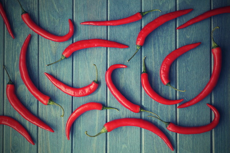 red chili peppers on a blue wooden background