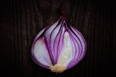 halved: halved red onion on wooden background Stock Photo