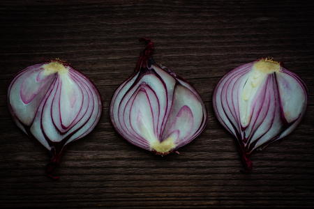 red onion: halved red onion on wooden background Stock Photo