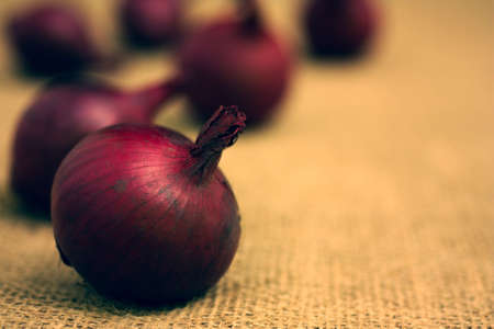 close up red onion on a brown background Stock Photo